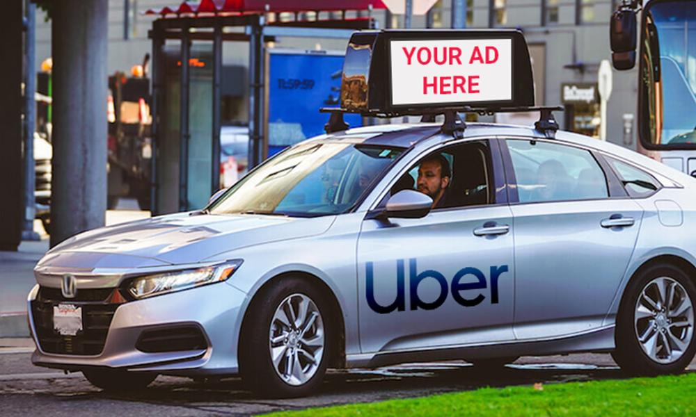 """En manque de liquidités, Uber autorise la pub sur """"ses"""" voitures"""